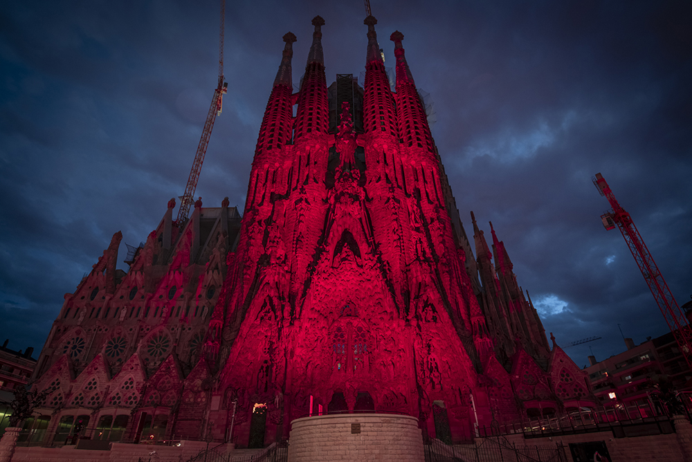 Sagrada Família lit up in red in recognition of all the work by Càritas during the Covid-19 healthcare crisis
